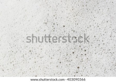 white foam with some bubbles, soft focus - stock photo