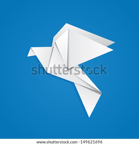 White folded paper, origami pigeon on blue background. - stock photo