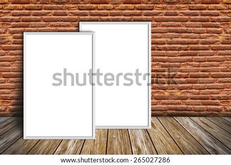 white frame on a brick wall and wooden floor