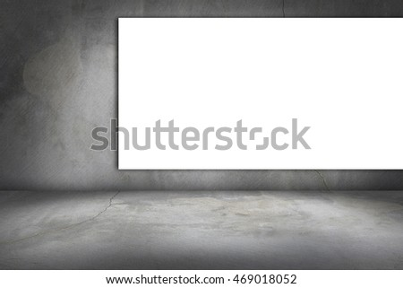 white frame on a concrete wall and floor