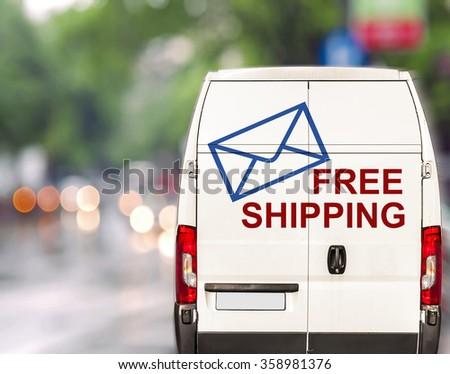 White free shipping Van driving fast on city blurr bokeh street - stock photo