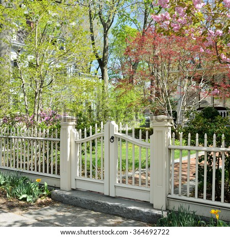 White gate, spring garden - stock photo