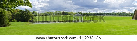 White Gazebo by a Pond - stock photo