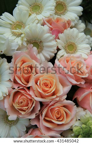 white gerberas and pink roses in a wedding flower arrangement