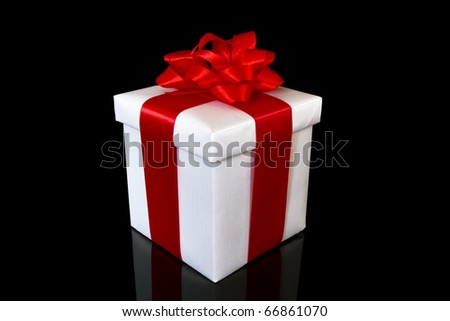 white gift box on the black background - stock photo