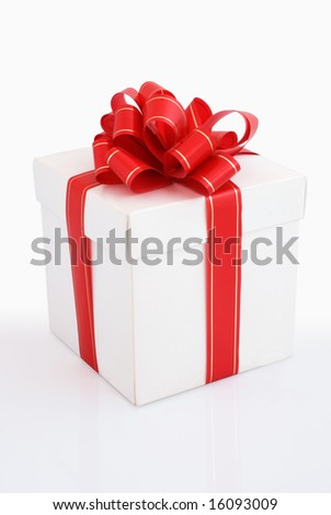 White gift box with red and gold ribbon on white background that mirrored box
