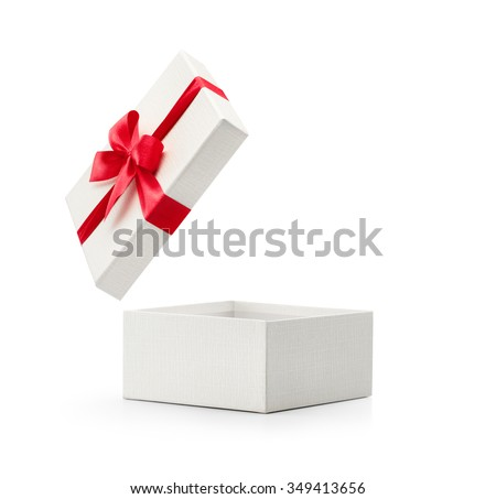 White gift box with red bow isolated on white background - Clipping path included - stock photo