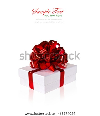 White gift box with red ribbon and bow on white background with copy space. - stock photo