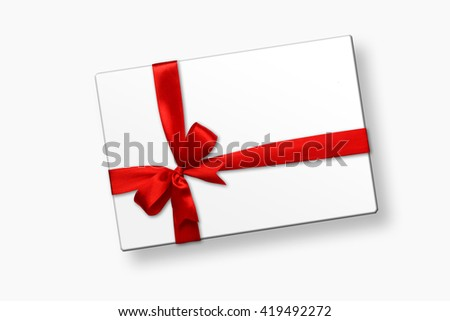 White gift box with red ribbon bow, isolated on white. Top view