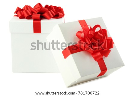 White gift boxes with ribbon isolated on white