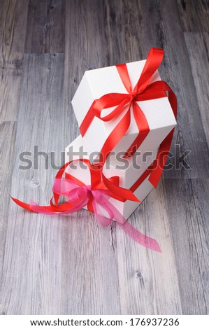 White gifts with red ribbons - stock photo