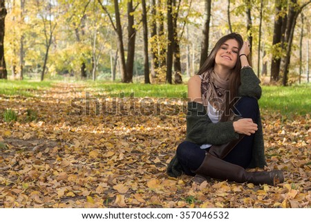 White girl with blue eyes posing in the forest in autumn.