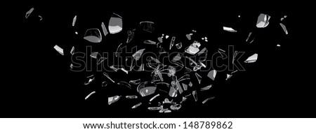white glass shards scattered across black surface - stock photo