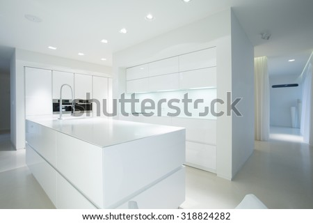 White gleaming kitchen unit in sterile interior - stock photo