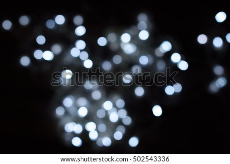 White glitter bokeh lights defocused background