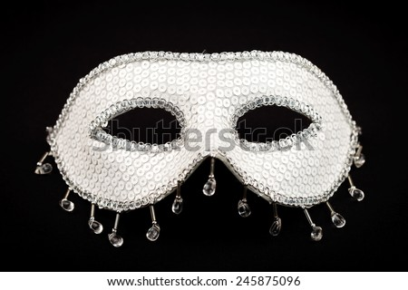 White glittering carnival mask isolated on black - stock photo