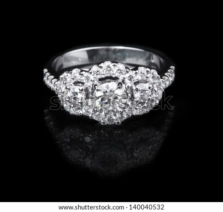 White gold diamond ring on black background - stock photo