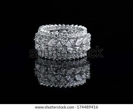 White gold diamond ring on black background  - stock photo