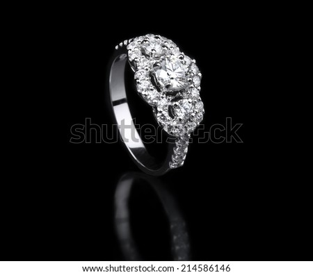 White gold diamond ring standing position on black background  - stock photo