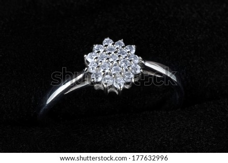 White gold ring with diamonds isolated on black, macro - stock photo