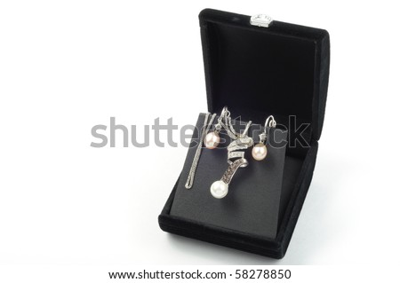 white gold set with pearls in open black gift box - stock photo