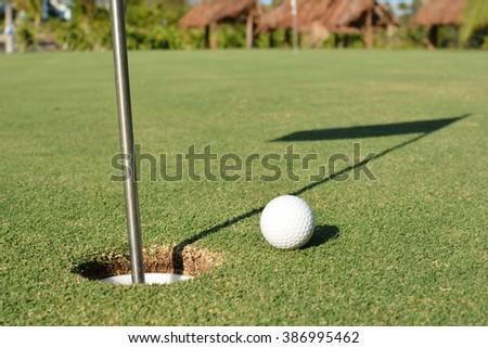 how to cut a hole in a tennis ball