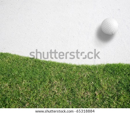 white Golf ball on the white sand Near green grass background,Golf sport is Balance of Yin Yang.copy space left and right for adding text.