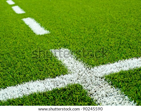 White grass lines on a soccer (football) field. - stock photo