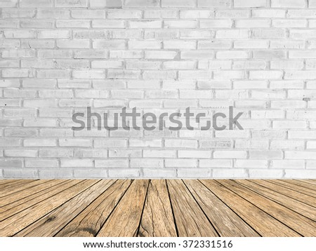 white/gray color brick stone cement wall background texture with aged yellow wood tiles floor:pure brickwork concrete wallpaper:stucco backdrop interior.showing,advertising,promote products at display - stock photo