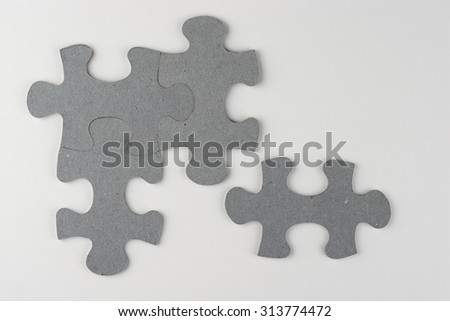White grey empty copy space background with grey puzzle pieces