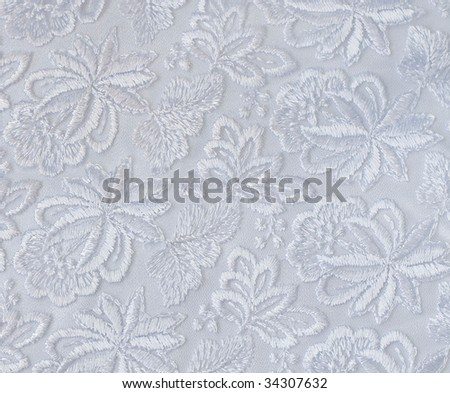 White guipure, embroidery on cloth for wedding dress, texture - stock photo