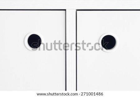 White handle cabinet - stock photo