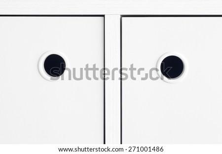 White handle cabinet - stock photo
