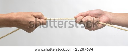 white hands in tug of war - stock photo