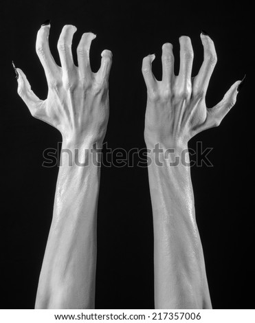white hands of death with black nails, white death, the devil's hands, the hands of a demon, white skin, halloween theme, black background, isolated - stock photo