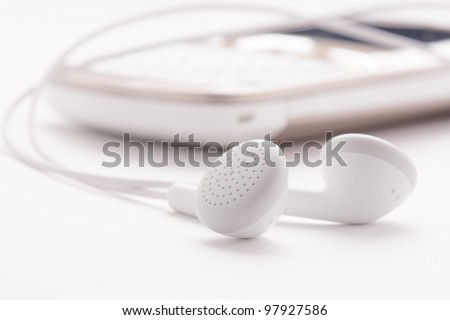 White headphones and phone - stock photo