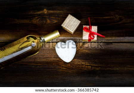 White Heart With Drops Of Rain, Bottle Of White Wine And Gift Boxes On Wooden Board. Love Concept. Valentines Day Background. - stock photo