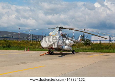 white helicopter on the platform airport in the sun in summer - stock photo