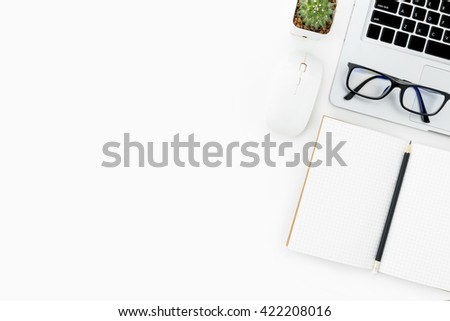 White hipster desk with laptop and supplies. Top view with copy space. - stock photo