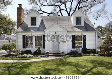 White home in suburbs with brick sidewalk - stock photo