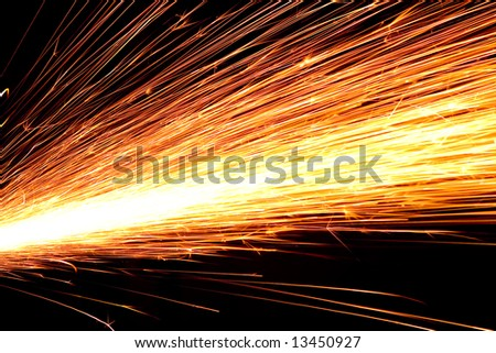 White hot sparks at grinding steel material - stock photo
