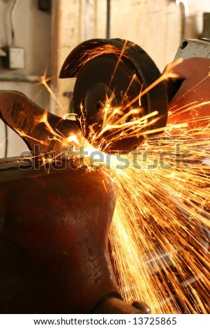 White hot sparks at grinding steel material