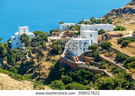 White hotels on the blue sea side on Ios island, Greece