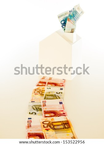 white house at the end of a curving path of euro banknotes with banknotes coming out of the chimney. concept rising cost of living. - stock photo