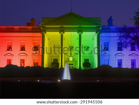 White House in evening, Washington, DC with Rainbow Flag projected onto it, symbolizing screen court decision for the right of LGBT (Lesbians, Gays, Bisexuals and Trans-genders to marry).  - stock photo