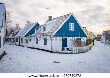 White house in winter in Sweden - stock photo