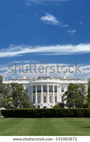 White House over deep blue cloudy sky - stock photo