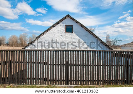 White house with black shutters and white picket fence  - stock photo