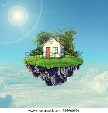 White house with brown roof and on island in sky with clouds and sun - stock photo