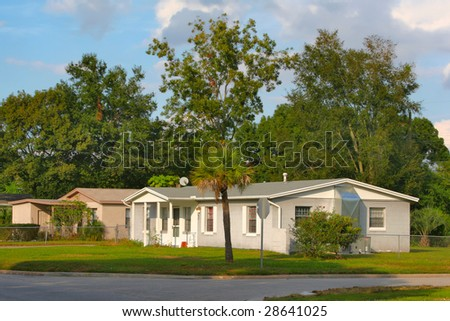 white house with trees - stock photo